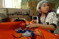 Worker, Liu Su Jung makes a Disney carrier bag at the Richall factory that makes woven plastic bags can be used many times and are seen as environmentally friendly. The comapany makes plastic bags for several clients including Disney and Sainsbury's.<br /> <br /> Photo by Richard Jones / Sinopix