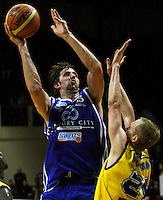 Kevin Owens shoots past Jay Anderson during the NBL Basketball match between Wellington Saints and Otago Nuggets at TSB Bank Arena, Wellington, New Zealand on Sunday, 30 March 2008. Photo: Dave Lintott / lintottphoto.co.nz