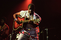 Manecas Costa <br /> A singer-songwriter and guitarist from Guinea Bissau, <br /> WOMAD Festival, Reading, England, July 2003.