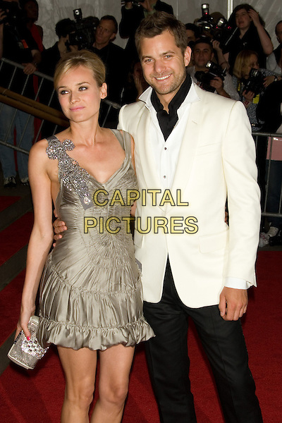 "DIANE KRUGER & JOSHUA JACKSON.Costume Institute Gala - ""Superheroes: Fashion and Fantasy"" at The Metropolitan Museum of Art, New York, NY, USA..May 5th, 2008 .half length beige brown gold dress white suit jacket couple clutch bag purse ruffles ruffled .CAP/LNC.©TOM/LNC/Capital Pictures."