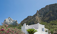 The house on the island of La Palmarola is dwarfed by the size of the craggy mountain