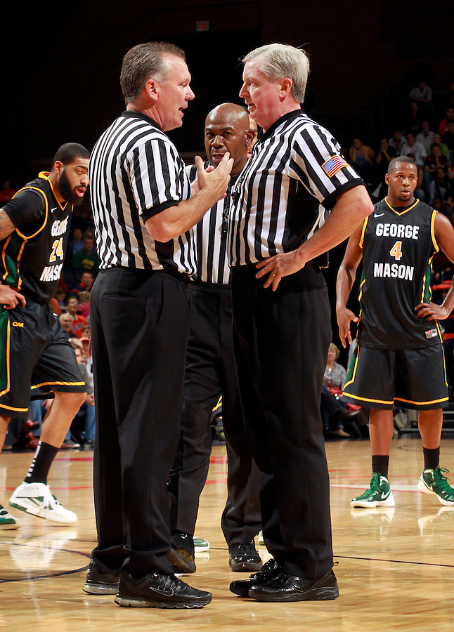 CHARLOTTESVILLE, VA- DECEMBER 6: Referees confirm a call during the Virginia Cavaliers vs the George Mason Patriots game on December 6, 2011 at the John Paul Jones Arena in Charlottesville, Virginia. Virginia defeated George Mason 68-48. (Photo by Andrew Shurtleff/Getty Images) *** Local Caption ***