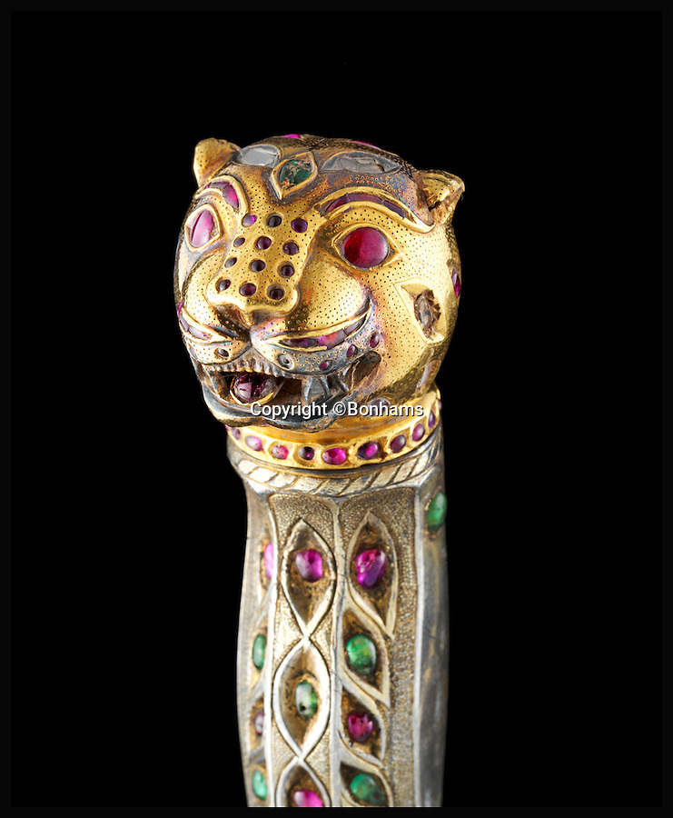 BNPS.co.uk (01202 558833)<br /> Pic: Bonhams/BNPS<br /> <br /> Tigers burning bright - Astonishing £6 million sale of Tipu Sultan treasure.<br /> <br /> This gem-set sword with tiger's head pommel, expected to sell for only £80,000, it went for an astonishing £2.1 million.<br /> <br /> Wellington's first worthy adversary on his way to Waterloo.<br /> <br /> An incredible bounty of exotic artefacts looted from the defeated Indian ruler who set the young Duke of Wellington on the road to his Waterloo victory has sold for a whopping £6 million - Six times its estimate.<br /> <br /> The stunning relics were raided from the palace of Tipu Sultan in the heart of India in the wake of defeat by British forces led by 30-year-old army colonel Wellington in the late 18th century.<br /> <br /> Wellington, then a young Arthur Wellesley, earned his spurs and learned skills fighting Tipu that would later prove vital in defeating French dictator Napoleon on the battlefields of Waterloo over two decades later.<br /> <br /> In the wake of the victory, British soldiers pillaged the city and Tipu's palace, helping themselves to the wealthy sultan's gold, jewellery, arms and armour, clothing and even furniture plundered from the palace.<br /> <br /> London auctioneers Bonhams staged the auction of more than 30 items collected over three decades by British Tipu expert Robin Wigington.
