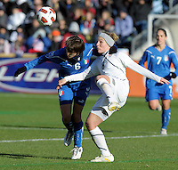 US forward Amy Rodriguez (8) battles for the ball with Italian defender Laura Neboli (6).  The U.S. Women's National Team defeated Italy 1-0 at Toyota Park in Bridgeview, IL on November 27, 2010 to advance to the Women's World Cup in Germany.