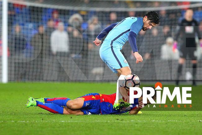 Manchester City's Nolito tackles Mathieu Flamini of Crystal Palaceduring the FA Cup fourth round match between Crystal Palace and Manchester City at Selhurst Park, London, England on 28 January 2017. Photo by PRiME Media Images / Steve McCarthy.
