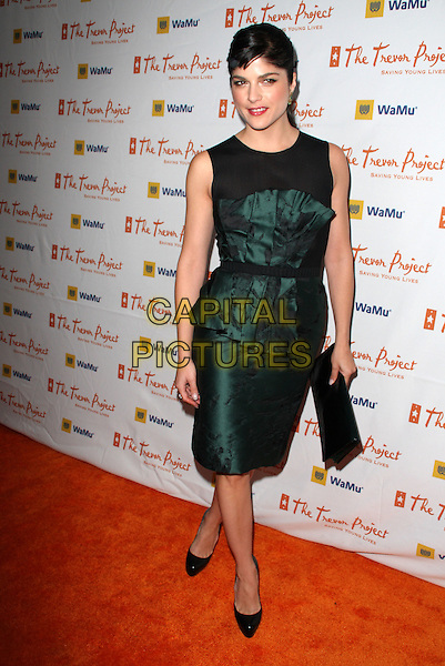 """SELMA BLAIR .11th Annual Trevor Project's """"Cracked XMas"""" Benefit at the Wiltern Theatre, Los Angeles, California, USA..December 7th, 2008.full length black green tank sleeveless bustier strapless dress shoes heels tie christian louboutin heels top skirt platforms clutch bag.CAP/ADM/KB.©Kevan Brooks/AdMedia/Capital Pictures."""
