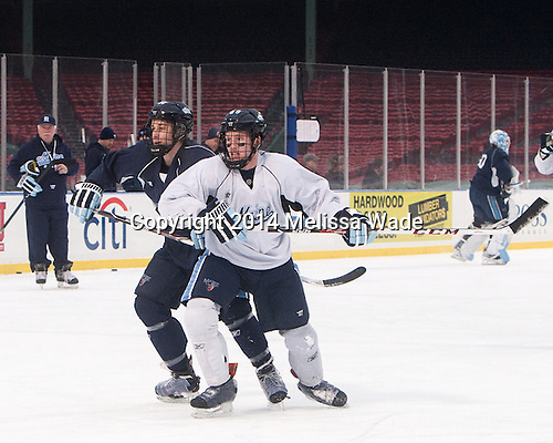 Bill Norman (Maine - 12), Brian Morgan (Maine - 88) - The participating teams in Hockey East's second doubleheader during Frozen Fenway practiced on January 10, 2014 at Fenway Park in Boston, Massachusetts.