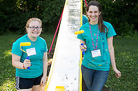 "Lauren Shafer, left, and Kia Adams pose for a photo during ""Circle the City with Service,"" the Kiwanis Circle K International's 2015 Large Scale Service Project, on Wednesday, June 24, 2015, at the Friendship Westside Center for Excellence in Indianapolis. (Photo by James Brosher)"