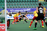The Hague, Netherlands, June 15: Stephen Jenness #27 of New Zealand shoots the ball during the field hockey placement match (Men - Place 7th/8th) between Spain and the Black Sticks of New Zealand on June 15, 2014 during the World Cup 2014 at Kyocera Stadium in The Hague, Netherlands.  Final score after full time 1-1 (0-1). The Black Sticks of New Zealand win the shoot-out 1-4.  (Photo by Dirk Markgraf / www.265-images.com) *** Local caption ***