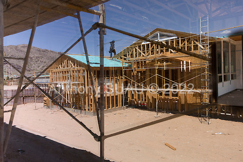 Phoenix, Arizona<br /> July 21, 2012<br /> <br /> New construction in Phoenix. Although many homes in Phoenix sit vacant most investors and banks, who own the homes, are holding them hoping to see prices rise to turn a profit. In the past few months housing in Phoenix has risen as much as 20% making it a strong market for investors. Construction of new housing has begun again in an artificially inflated market.