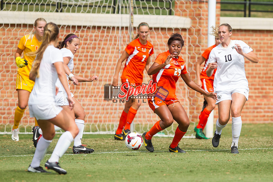 Blake Stockton (29) of the Miami Hurricanes looks to clear the ball away from the front of her goal during second half action against the Wake Forest Demon Deacons at Spry Soccer Stadium on September 15, 2013 in Winston-Salem, North Carolina.  The Deacons defeated the Hurricanes 4-0.   (Brian Westerholt/Sports On Film)