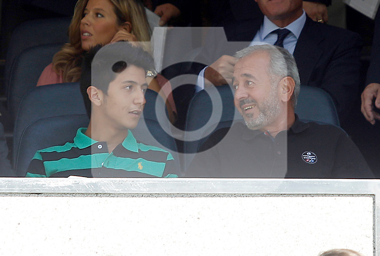 Syrian refugee, Osama Abdul Mohosen with his son Mohamad during Real Madrid vs Granada, La Liga match. September 19,2015. (ALTERPHOTOS/Acero)