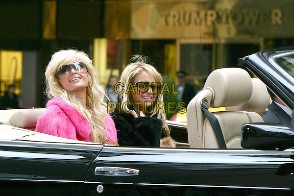 PARIS HILTON & NICOLE RICHIE.Shooting a commercial for the next season of their hit Fox reality tv show, The Simple Life 3, at Fendi on 5th Avenue in New York City..October 25, 2004.car, backseat, headshot, portrait, sunglasses, shades, pink fur.www.capitalpictures.com.sales@capitalpictures.com.©Capital Pictures