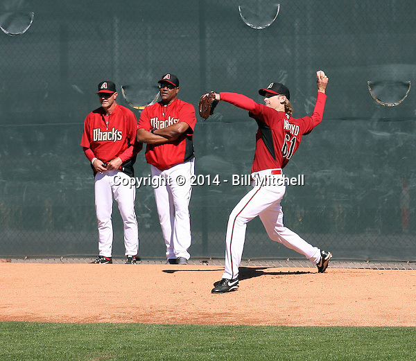 Bronson Arroyo of the Arizona Diamondbacks participates in his first spring training workout after signing a two-year contract wtih the team at Salt River Fields on February 12, 2014 in Scottsdale, Arizona. Arroyo is watched by manager Kirk Gibson (L) and pitching coach Mike Harkey (R) (Bill Mitchell)