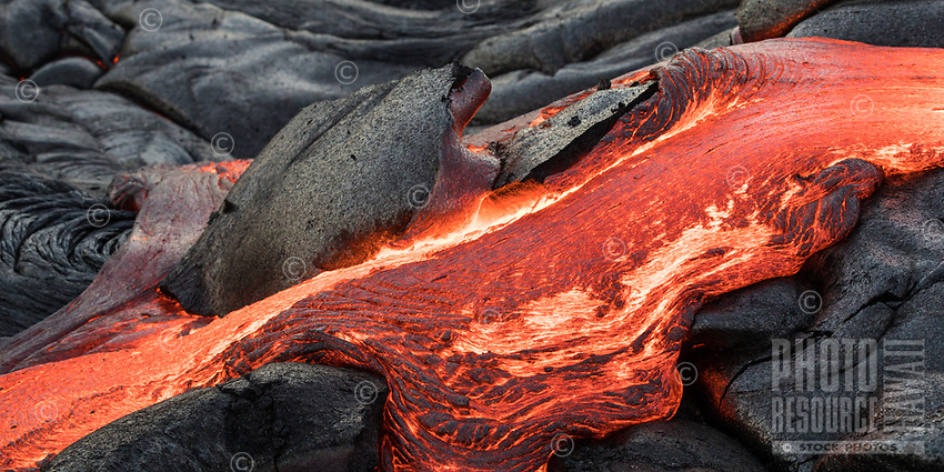 Lava flows over and through the coastal plains of Pulama Pali, Hawai'i Volcanoes National Park, Puna, Hawai'i Island, January 2018.