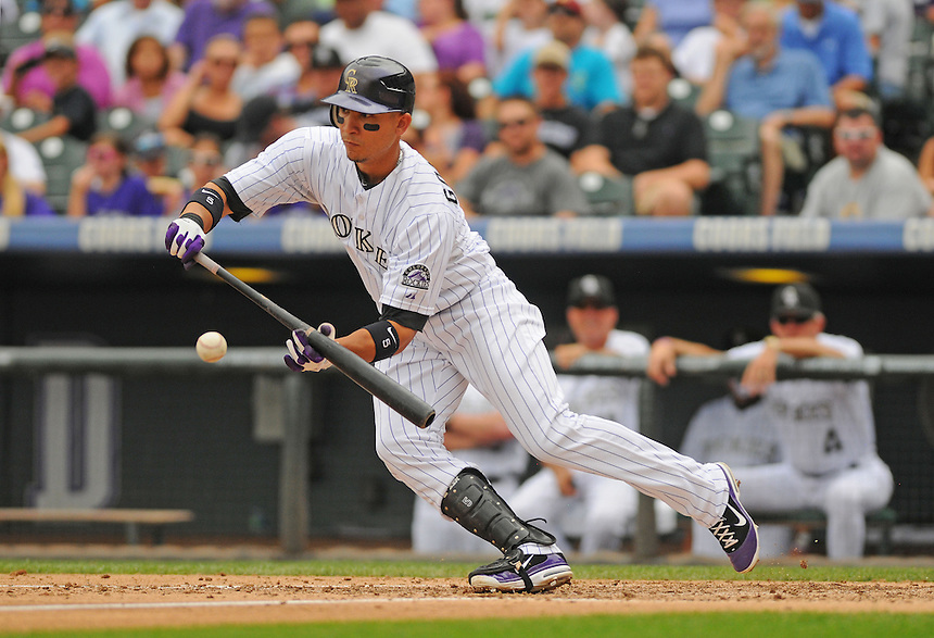 21 AUGUST 2011:  Colorado Rockies left fielder Carlos Gonzalez (5) attempts a bunt hit  during a regular season game between the Los Angeles Dodgers and the Colorado Rockies at Coors Field in Denver, Colorado. The Rockies beat the Dodgers 5-3. *****For Editorial Use Only*****