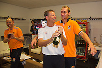 14-sept.-2013,Netherlands, Groningen,  Martini Plaza, Tennis, DavisCup Netherlands-Austria, Doubles,   Dutch winning doubles,  Champagne is opened by captain Jan Siemerink, right Thiemo de Bakker left, team manager  Robert Jan Schumacher<br /> Photo: Henk Koster
