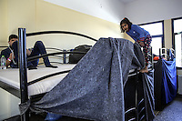 Pictured: Refugees at the camp Friday 26 February 2016<br /> Re: Hundreds of refugees have been given temporary shelter at the Stefanakis Army Camp in the Schisto area of Athens, Greece.