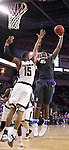 SIOUX FALLS, SD: MARCH 5: Brent Calhoun #45 of IPFW shoots over Tre'Shawn Thurman #15 of Omaha during the Summit League Basketball Championship on March 5, 2017 at the Denny Sanford Premier Center in Sioux Falls, SD. (Photo by Dick Carlson/Inertia)
