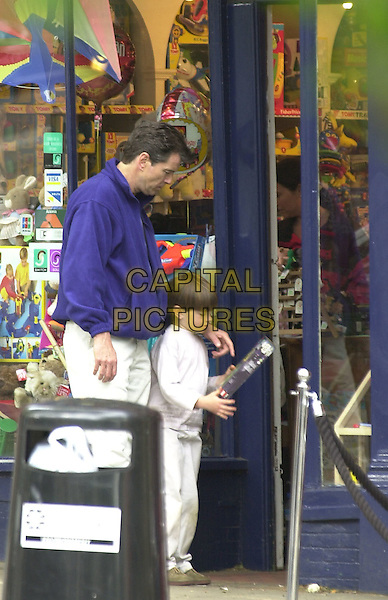 "PIERCE BROSNAN.with wife (inside shop, in red)  and son shopping in ""Happy Returns, Toy and Party Shop"" where they bought a Lego Star Wars toy..full length paparazzi.*Exclusive*.*Fees must be agreed before use*.© Capital Pictures.www.capitalpictures.com.tel +44 (0)20 7253 1122.sales@capitalpictures.com"