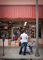 Shoppers hang out along Main Street in downtown McAllen, Texas, Sunday, April 4, 2010. Downtown McAllen stores don't sell designer or name brand items, but still reach a wide customer base for McAllen residents and visiting Mexican tourists. ...PHOTO/ Matt Nager