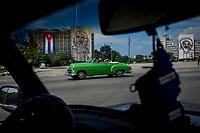 HAVANA, CUBA - JUNE 14: Tourists are driven by a Cuban tour guide, past Plaza de la Revolution in Havana, on 14th June, 2015 in Havana, Cuba. <br /> Daniel Berehulak for Panasonic/Lumix