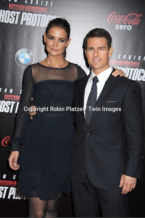 "Katie Holmes and Tom Cruise attend The US Premiere of "" Mission:Impossible - Ghost Protocol "" on December 19, 2011 at the Ziegfeld Theatre. .the movie stars Tom Cruise, Paula Patton, Jeremy Renner, Simon Pegg, Josh Holloway, Michael Nyqvist and Anil Kapoor."