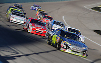 Nov. 16, 2008; Homestead, FL, USA; NASCAR Sprint Cup Series driver Jimmie Johnson leads a pack of cars during the Ford 400 at Homestead Miami Speedway. Mandatory Credit: Mark J. Rebilas-