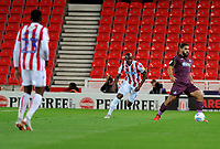 Benik Afobe of Stoke City vies for possession with Cameron Carter-Vickers of Swansea City during the Sky Bet Championship match between Stoke City and Swansea City at the Bet 365 Stadium in Stoke on Trent, England, UK. Tuesday 18 September 2018
