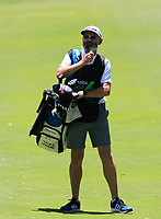 Nick Pugh (caddy) for Jazz Janewattananond (THA) in action on the 1st during Round 1 of the ISPS Handa World Super 6 Perth at Lake Karrinyup Country Club on the Thursday 8th February 2018.<br /> Picture:  Thos Caffrey / www.golffile.ie<br /> <br /> All photo usage must carry mandatory copyright credit (&copy; Golffile | Thos Caffrey)
