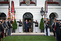United States President Donald J. Trump salutes as he and and first lady Melania Trump emerge from the Diplomatic Entrance to observe a moment of silence at 8:46am EDT in commemoration of  the 18th anniversary of the terrorist attacks on the World Trade Center in New York, NY and the Pentagon in Washington, DC on Wednesday, September 11, 2019.<br /> Credit: Ron Sachs / CNP /MediaPunch
