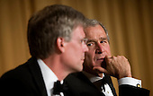 Washington, D.C. - April 21, 2007 - United States President George W Bush (R) looks to his spokesperson Tony Snow (L), who has not served since cancer was discovered during a surgery, at the White House Correspondence Association Dinner April 21, 2007 in Washington, DC.  Comedian Rich Little hosted and provided entertainment for Bush, White House reporters, their guests and celebrities. .Credit: Brendan Smialowski - Pool via CNP