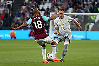 Phil Jones of Manchester United and Joao Mario of West Ham United during West Ham United vs Manchester United, Premier League Football at The London Stadium on 10th May 2018