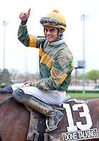 Jockey Sheldon Russell gives a thumbs up after winning the GIII TVG Illinois Derby at Hawthorne Race Course in Cicero/Stickney, IL.
