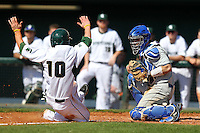 Catcher Frank Esposito #11 of the Seton Hall Pirates takes the throw as Ryan Jones #10 slides into home during the Big East-Big Ten Challenge vs. the Michigan State Spartans at Al Lang Field in St. Petersburg, Florida;  February 19, 2011.  Michigan State defeated Seton Hall 5-4.  Photo By Mike Janes/Four Seam Images