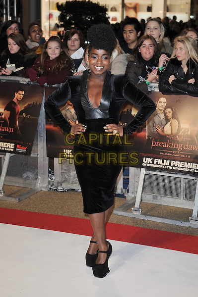 Misha Bryan.'The Twilight Saga: Breaking Dawn - Part 1' UK film premiere at Westfield Stratford City, London, England..16th November 2011.full length black dress leather hands on hip plunging neckline platform shoes velvet cleavage .CAP/MAR.© Martin Harris/Capital Pictures.