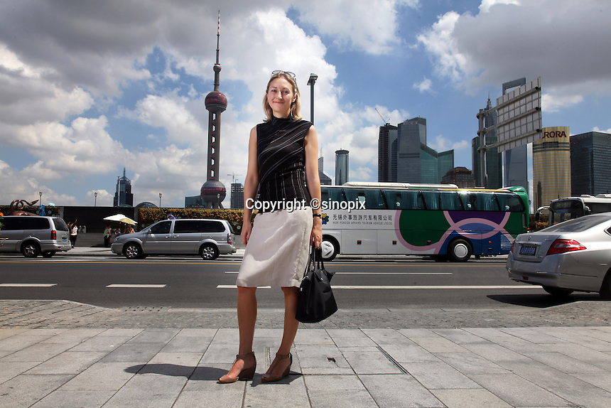 Aline Conus poses in front of the bund, Shanghai.<br />