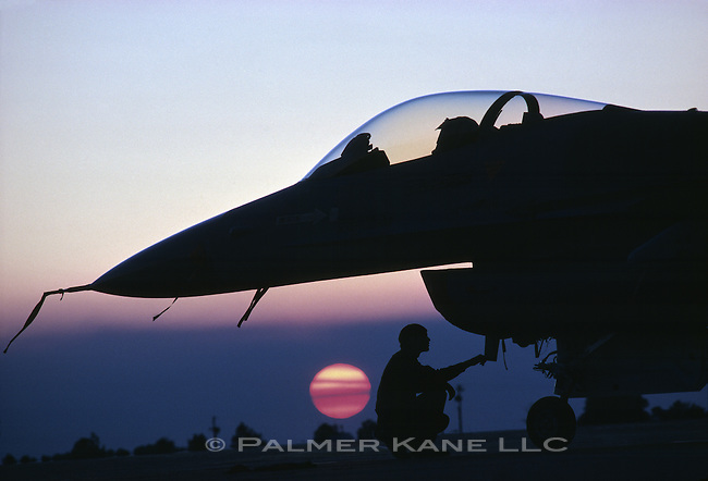 Silhouette of F14 crew at sunset. Eglin AFB