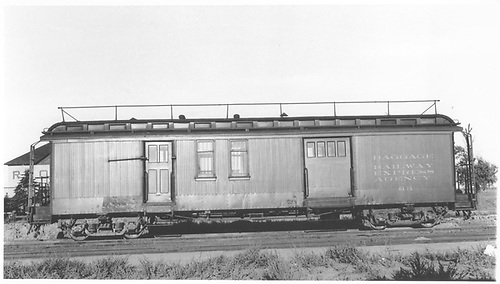 #63 baggage &amp; RPO combine car with handrail on roof at Antonito.  Side view.<br /> D&amp;RGW  Antonito, CO  8/30/1941