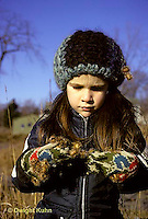 BD02-005z  Burdocks - girl with burdock seeds on glove, seed dispersal - Arctium minus