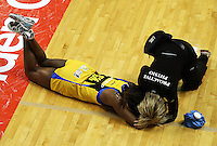 Pulse goal keep Althea Byfield is checked after banging her head on the floor during the ANZ Netball Championship match between the Central Pulse and Northern Mystics, TSB Bank Arena, Wellington, New Zealand on Monday, 4 May 2009. Photo: Dave Lintott / lintottphoto.co.nz