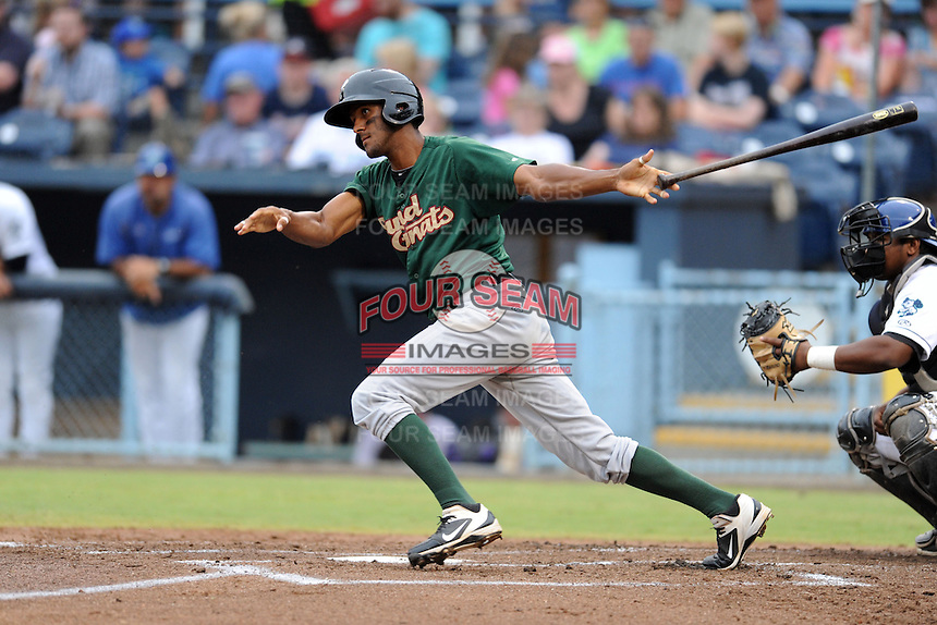 Savannah Sand Gnats right fielder Eudy Pina #32 swings at a pitch during a game against the Asheville Tourists at McCormick Field on July 30, 2013 in Asheville, North Carolina. The Sand Gnats won the game 9-5. (Tony Farlow/Four Seam Images)