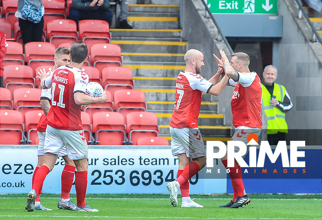 Fleetwood Town's defender Peter Clarke (4) congratulates Fleetwood Town's forward Patrick Madden (17) during the Sky Bet League 1 match between Fleetwood Town and AFC Wimbledon at Highbury Stadium, Fleetwood, England on 10 August 2019. Photo by Stephen Buckley / PRiME Media Images.