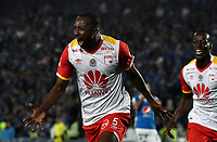 BOGOTA - COLOMBIA - 16 – 07 - 2017: Juan David Valencia,  jugador de El Independiente Santa Fe, corre a celebrar el gol anotado a Millonarios, durante partido de la fecha 2 entre Millonarios y el Independiente Santa Fe, por la Liga Aguila II-2017, jugado en el estadio Nemesio Camacho El Campin de la ciudad de Bogota. / Juan David Valencia, player of Independiente Santa Fe, run to celebrates a goal scored to Millonarios, during a match of the date 2nd between Millonarios and Independiente Santa Fe, for the Liga Aguila II-2017 played at the Nemesio Camacho El Campin Stadium in Bogota city, Photo: VizzorImage / Luis Ramirez / Staff.