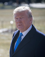 United States President Donald J. Trump walks away after making a statement to the media as he prepares to depart the White House in Washington, DC for a weekend of bicameral meetings with Republican leaders at Camp David on Friday, January 5, 2018.<br /> CAP/MPI/RS<br /> &copy;RS/MPI/Capital Pictures