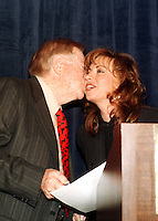 Abe Hirschfeld kisses Paula Jones as they appear at a press conference called by him where he presented her with a check for one million dollars to settle her sexual harassment lawsuit against United States President Bill Clinton at the Mayflower Hotel in Washington, DC on 31 October, 1998.<br /> Credit: Ron Sachs / CNP /MediaPunch