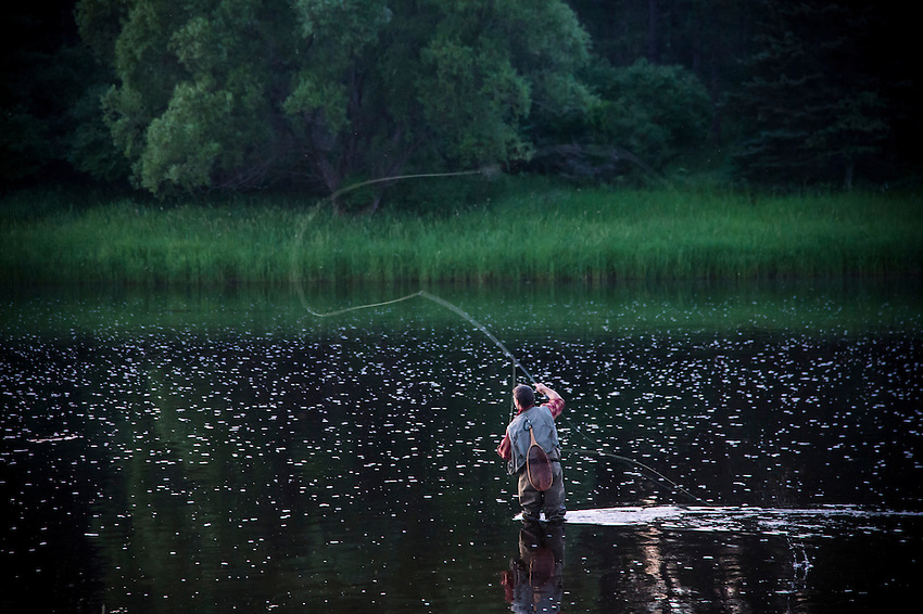 Fly fishing the Escanaba River on Michigan's Upper Peninsula at dusk.