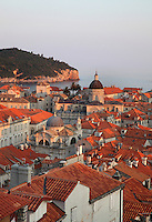 View over the rooftops of the medieval walled city with the Cathedral, St Blaise Church and Lokrum island behind, Dubrovnik, Croatia. The city developed as an important port in the 15th and 16th centuries and has had a multicultural history, allied to the Romans, Ostrogoths, Byzantines, Ancona, Hungary and the Ottomans. In 1979 the city was listed as a UNESCO World Heritage Site. Picture by Manuel Cohen