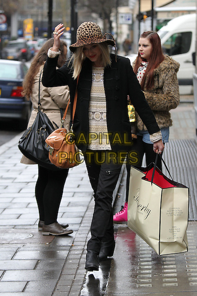 Fearne Cotton leaving the BBC Radio 1 studios, London, England..January 20th, 2011.full length black coat jacket trousers brown leopard print hat white cream beige top bag purse hand arm crochet.CAP/CAN.©Can Nguyen/Capital Pictures.