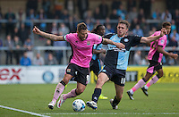 Dan Rowe of Wycombe Wanderers tackles Marc Richards of Northampton Town during the Sky Bet League 2 match between Wycombe Wanderers and Northampton Town at Adams Park, High Wycombe, England on 3 October 2015. Photo by Andy Rowland.